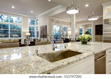 White Kitchen Design Features Large Bar Style Kitchen Island With Granite  Countertop Illuminated By Modern Pendant Part 68