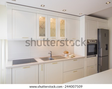 White kitchen interior - stock photo