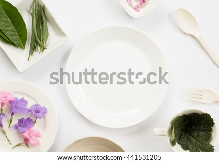 White kitchenware with  leaves and flower decorate isolated on white background. flat lay, overhead view, top view