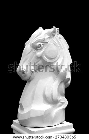 white knight chess piece on the black background sign horse of chess isolated  - stock photo