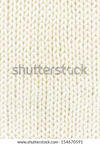 white knitted background. texture knitted-pigtail.