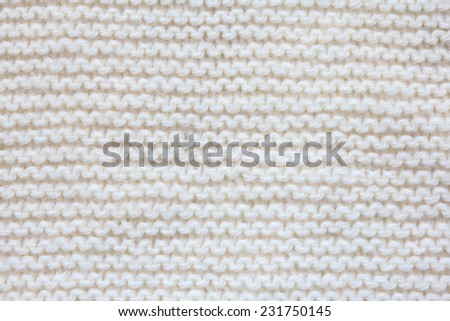 White  knitted fabric texture - stock photo