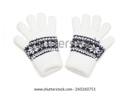 White knitted winter gloves - stock photo