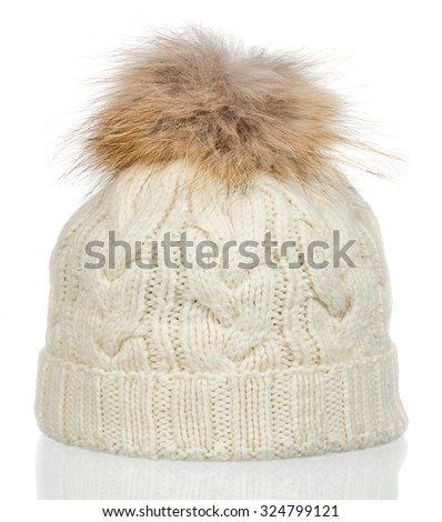 white knitted wool hat with isolated on white background - stock photo