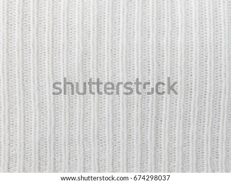 White Knitting Or Knitted Fabric Texture Pattern Background
