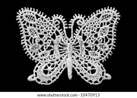White lace butterfly on black background. - stock photo