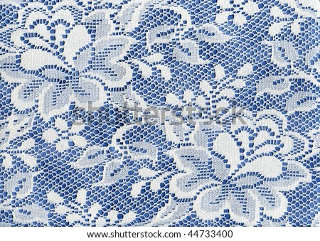 White Lace Floral Fabric On Blue Background Cloth - stock photo