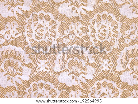 white lace on Beige background. - stock photo