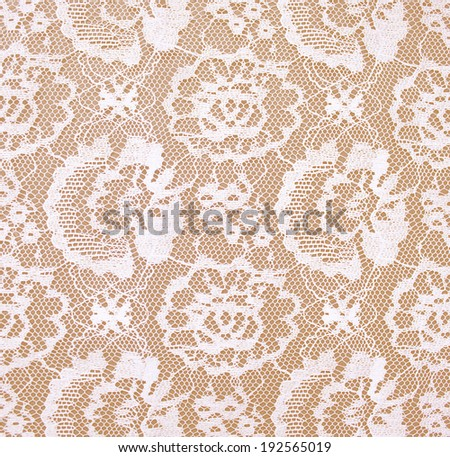 white lace on Beige background.