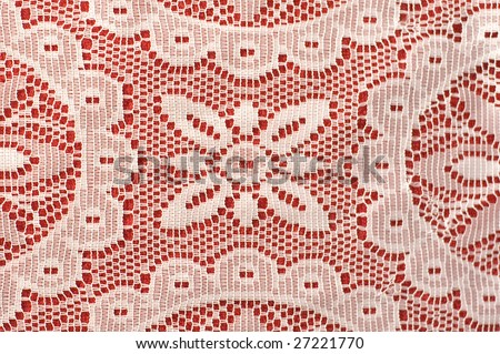 White lace on red background - stock photo