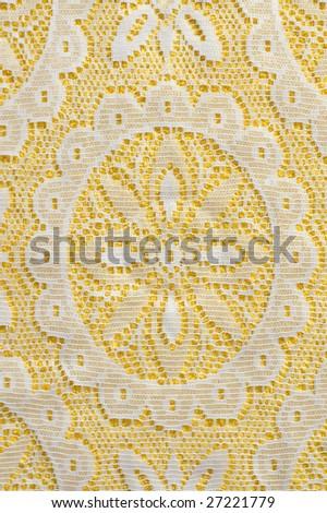 White lace on yellow background - stock photo