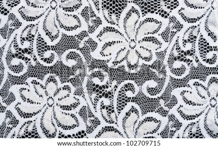 White lace tracery on a black background - stock photo