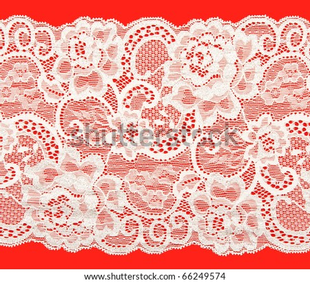 White lace with a floral pattern on a red background