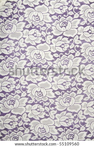 White lace with floral pattern on black background - stock photo