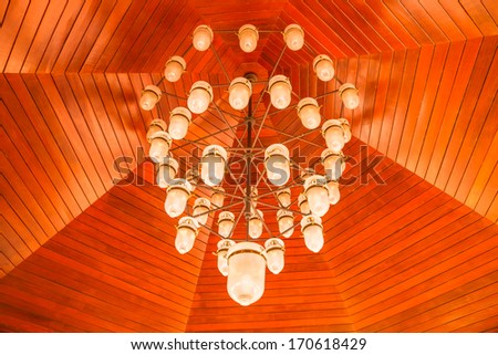 White lamp under wood ceiling - stock photo