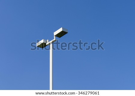 white lamppost pole with daylight blue sky background