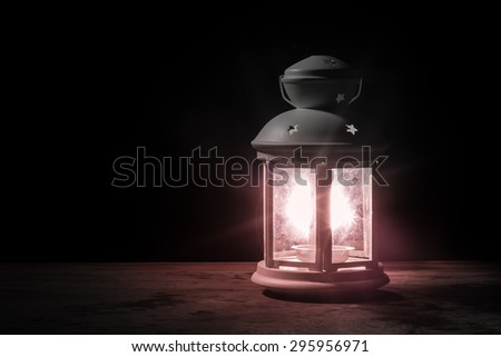 White lantern light on wooden background with copyspace