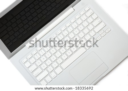 White laptop with keyboard reflection on display. Isolated on white background. Tilt view.