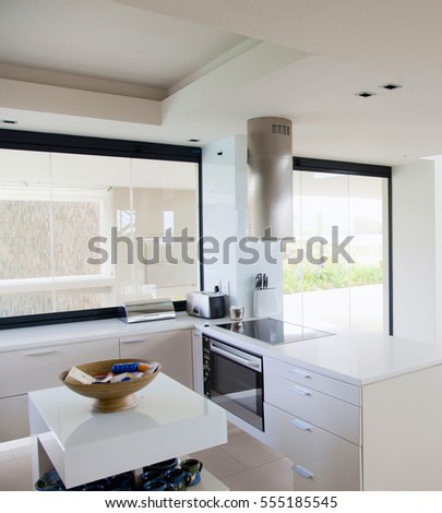 White large luxury room. Full view of a modern kitchen. Interior kitchen with electric. Interior of modern and bright kitchen. Large kitchen in luxury home
