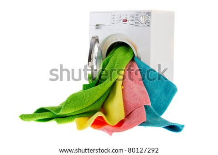 White laundromat with colorful landry in open door - stock photo