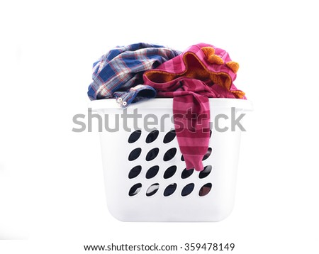 White laundry basket full of clothes