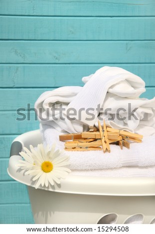 White laundry basket with folded towels and socks - stock photo