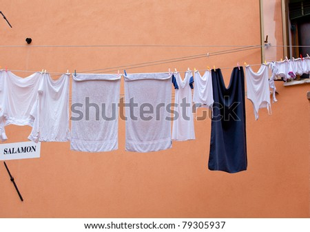 White laundry hanging to dry on a clothes-line. - stock photo