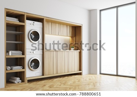 White Laundry Room Interior With Wooden Countertops A Closet And Built In Washing Machines