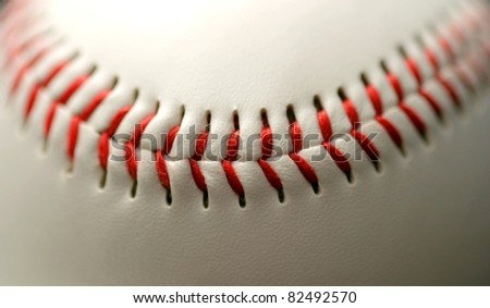 white leather base ball with red stitching - stock photo