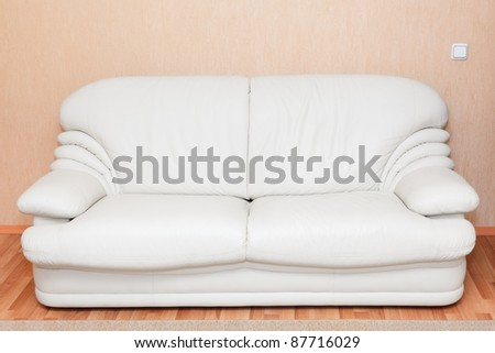 White leather couch in the room interior - stock photo