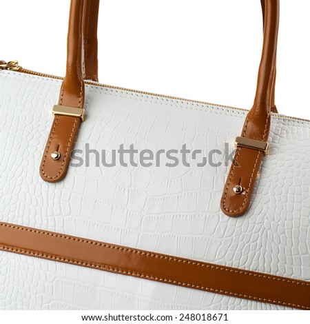 White leather handbag with brown handles isolated on white. - stock photo