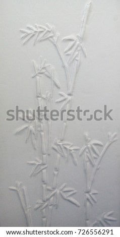 white leather relief of bamboo. carved bamboo leaf.