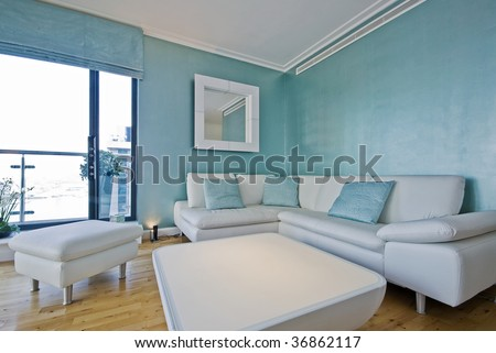Perfect White Leather Sofa In A Light Blue Living Room