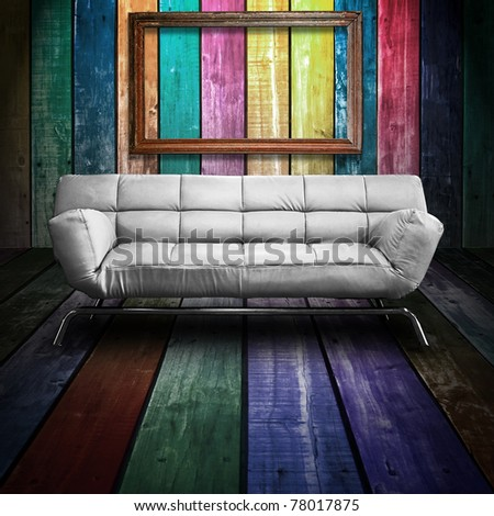 White leather sofa in Colorful Wood Room - stock photo