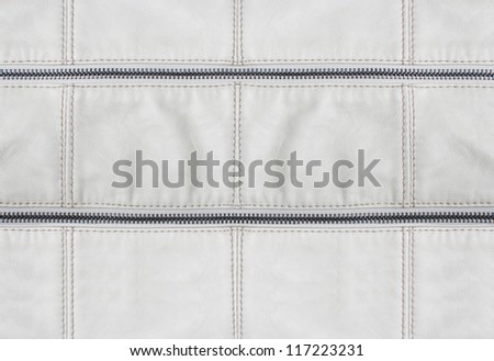 White leather texture and zipper background - stock photo
