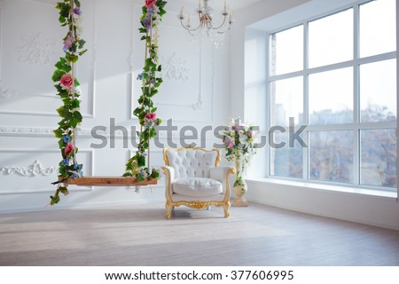 White leather vintage style chair in classical interior room with big window and spring flowers - stock photo