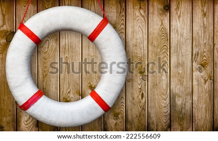 White lifebuoy on a wooden wall - stock photo