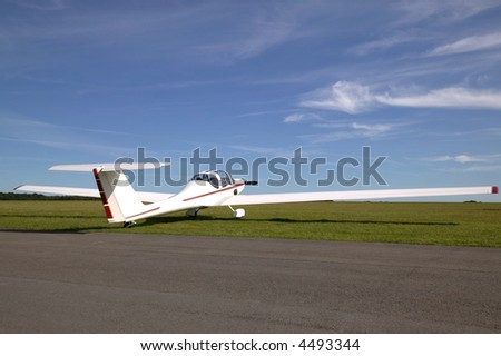 White light aircraft besides a runway. - stock photo