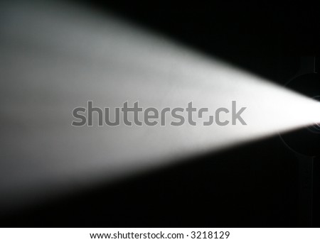 White Light Beam from Projector on Black Background - stock photo
