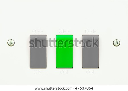 white light socket with a green switch