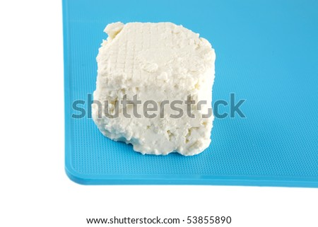 white light soft feta cheese on plate - stock photo