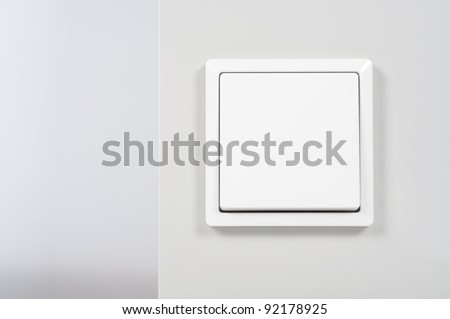 white light switch on the wall - stock photo
