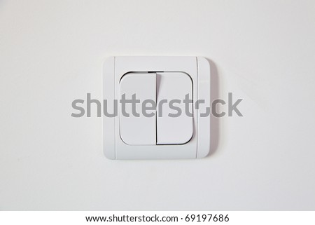 white light switch on white wall - stock photo