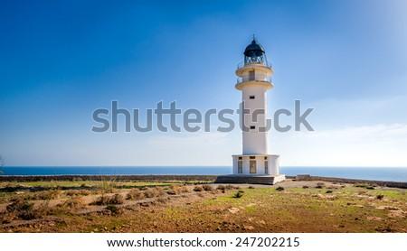 White lighthouse at Formentera island. Spain Balearic islands - stock photo