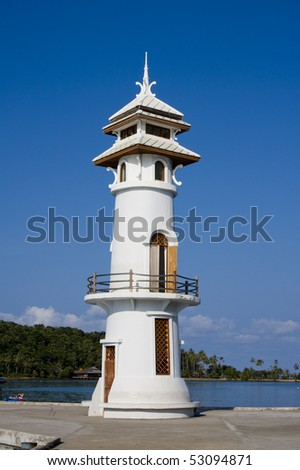 White lighthouse in bay on Koh Chang island, Thailand.