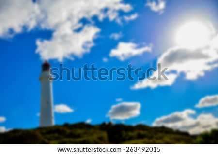 White lighthouse in blur style - stock photo