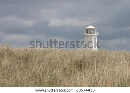 White Lighthouse in Nature Reserve on Walney Island - stock photo
