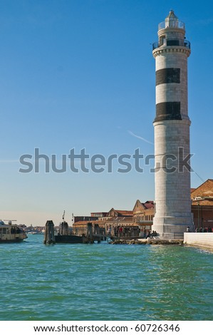 White lighthouse locatad at Murano Island, Italy
