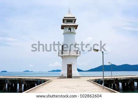 White lighthouse on jetty at Koh Chang island, Thailand