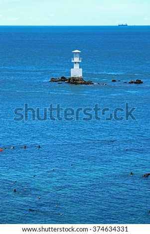 White lighthouse on the sea